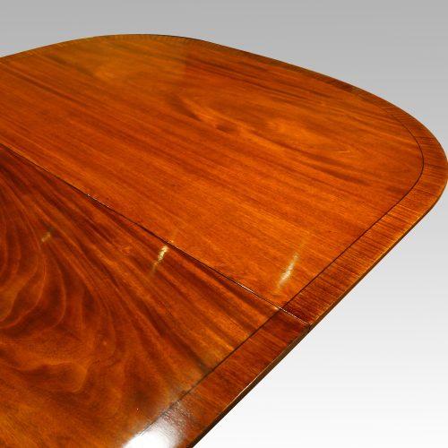 Georgian style mahogany twin pillar dining table cross banding