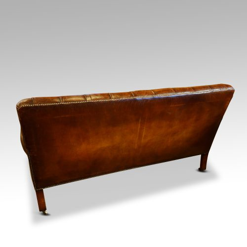 Victorian leather Gentlemans club sofa rear view