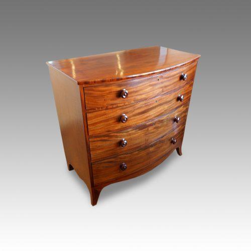 Georgian mahogany bow chest at angle