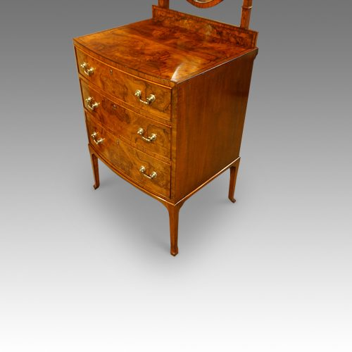 Walnut bow front dressing table angle view