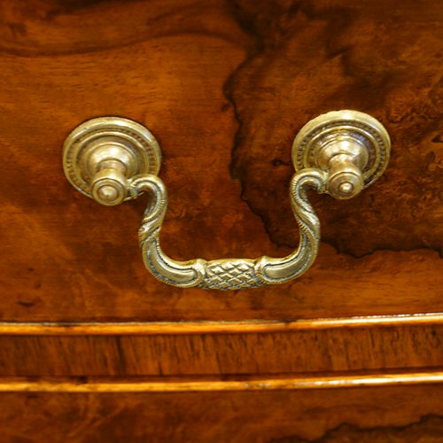 Walnut bow front dressing table handle